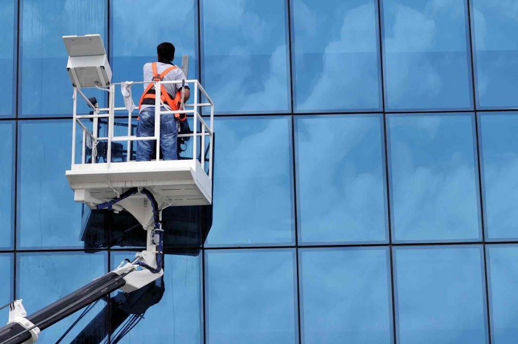 Window Washer Providing Cleaning Services
