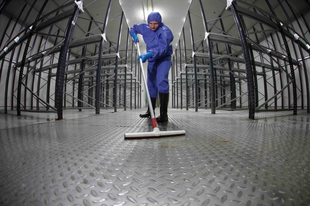 Man mopping floor providing commercial cleaning services